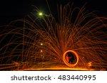 men fire spinning dusk  | Shutterstock . vector #483440995