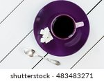 Cup Of Tea Or Coffee On Violet...