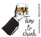 male hand holding a glass of... | Shutterstock .eps vector #483513439