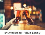 two friends toasting with... | Shutterstock . vector #483513559