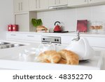 Kitchen in new modern townhouse - stock photo