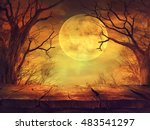 Stock photo halloween background spooky forest with full moon and wooden table 483541297