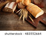 Fresh Bread On Wooden Table