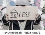 young homeless man holding... | Shutterstock . vector #483578071