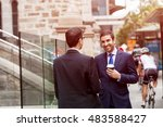 two businessmen talking outdoors | Shutterstock . vector #483588427