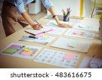 young woman standing near desk... | Shutterstock . vector #483616675