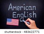 Small photo of American English. Hand drawing American English on blackboard. Close up.