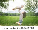 young mother rising baby up. | Shutterstock . vector #483652381