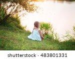 little girl in white dress on... | Shutterstock . vector #483801331
