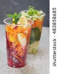 Small photo of Fruit and vegetable salad arranged in take away clear plastic cups, selective focus