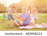 happy family having a picnic in ... | Shutterstock . vector #483908221