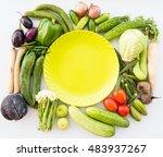 vegetables surround a round...