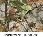 Realistic forest camouflage. Seamless pattern. Branches, green and brown oak leaves. Useable for hunting and military purposes.                                - stock photo