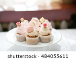 plate of delicious cakes with... | Shutterstock . vector #484055611