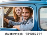 loving couple in old blue car ... | Shutterstock . vector #484081999