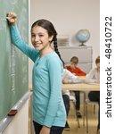student writing on blackboard | Shutterstock . vector #48410722