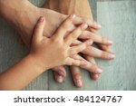 family hands on wooden... | Shutterstock . vector #484124767