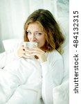 unhappy woman lying in bed and...   Shutterstock . vector #484132315