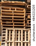 Small photo of Stacks of wooden shipping cargo pallet B