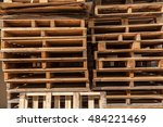 Small photo of Stacks of wooden shipping cargo pallet A