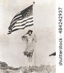 Patriotic Woman Holding...