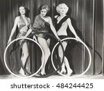 three scantily clad women... | Shutterstock . vector #484244425