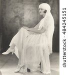 woman in white chiffon dress... | Shutterstock . vector #484245151