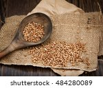 buckwheat in a wooden spoon on... | Shutterstock . vector #484280089
