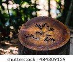 Symbol Of Frog On Cut Tree...
