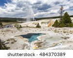 Small photo of The Beehive Geyser is named for its 4-foot high cone that resembles an old fashioned beehive. The cone acts as a nozzle, directing a column of steam and water to heights of up to 200 feet.