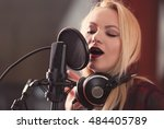 young woman recording a song in ... | Shutterstock . vector #484405789
