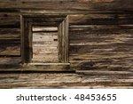 window of damaged wooden lodge - stock photo