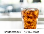 iced cola glass on the table | Shutterstock . vector #484634035