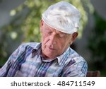 Small photo of Senior man fall asleep in courtyard in summer time