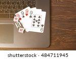 gambling online on notebook. | Shutterstock . vector #484711945