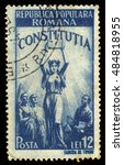 Small photo of ROMANIA - CIRCA 1948: A stamp printed in Romania shows allegorical image of the new Constitution, series new constitution, blue, circa 1948