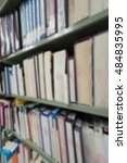 Small photo of Blurred abstract background of book shelves row and interior of college library with library textbooks,library literature,library manuscript, library thesis and library magazines. - Vintage Tone.
