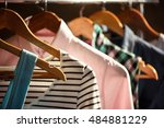trendy clothing on wooden... | Shutterstock . vector #484881229