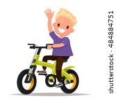 cheerful boy rides a bicycle.... | Shutterstock .eps vector #484884751