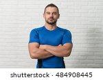 personal trainer standing... | Shutterstock . vector #484908445