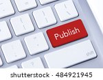 Small photo of Publish word in red keyboard buttons