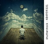 Small photo of Abstract idea with a person sitting in a dark room in front of a clock surrounded by limitations daily routine concrete walls with clouds texture. Time pressure deadline concept