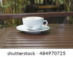 hot coffee on wood table | Shutterstock . vector #484970725