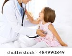 doctor examining a little girl... | Shutterstock . vector #484990849