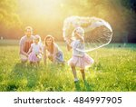 happy family in the park | Shutterstock . vector #484997905