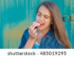 teen girl eating cookies  snack ... | Shutterstock . vector #485019295
