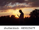 silhouette of a man praying in... | Shutterstock . vector #485025679