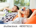 couple or roommates relaxing... | Shutterstock . vector #485073211
