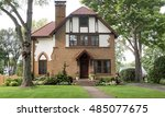 old tan brick house with red... | Shutterstock . vector #485077675