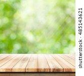empty wooden table with garden... | Shutterstock . vector #485143621